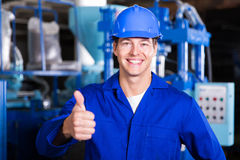 Worker thumb up stock photos