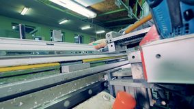 Worker tightening the screws using industrial electric screwdriver. 4K stock footage