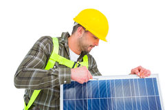 Worker tightening solar panel Stock Image