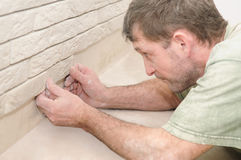 Worker tiler at wall decoration Royalty Free Stock Images