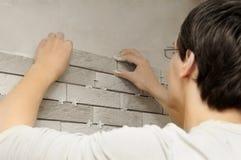 Worker tiler at work Royalty Free Stock Photos