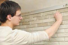 Worker tiler at work Stock Image