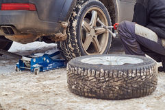 A worker of tire service replacing the wheels Royalty Free Stock Photography