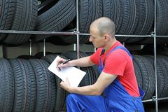 Worker in a tire workshop Royalty Free Stock Photography