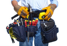 Worker with a tool belt. Isolated over white background royalty free stock photography