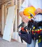 Worker with a tool belt. Construction industry royalty free stock image