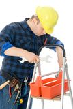 Worker and tool-box. Worker (handyman) is checking his tools in tool-box on ladder Stock Photography