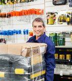 Worker With Tool Package In Hardware Shop Stock Photos
