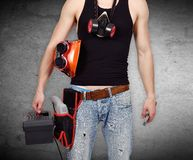 Worker with toolbelt and wrench Royalty Free Stock Images
