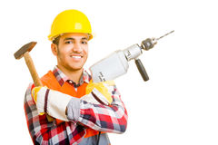 Worker with tools. Worker holding a hammer and a drilling machine Stock Photos