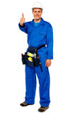 Worker with tools bag showing thumbs up. Standing against white background Stock Image