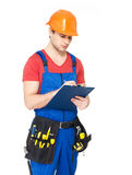 Worker with tools, planning and writing the note. Portrait of worker with tools, planning and writing the note isolated on white background Stock Images