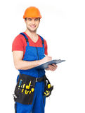Worker with tools, planning and writing the note Stock Image