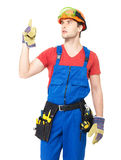 Worker with tools   points up with finher Royalty Free Stock Image