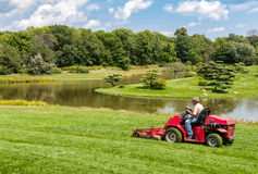 Worker with tractor mower in the Chicago Botanic Garden. royalty free stock images