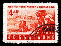 Worker and Tractor, 2nd National Peace Conference serie, circa 1950. MOSCOW, RUSSIA - SEPTEMBER 15, 2018: A stamp printed in Bulgaria shows Worker and Tractor stock image