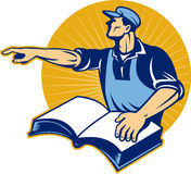 Worker tradesman man read book pointing Royalty Free Stock Photo
