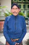 Worker in traditional Javanese costume posing in Kraton Sultan P stock photo