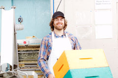 Worker transporting beehives. Worker transporting empty beehives ready for field royalty free stock photo