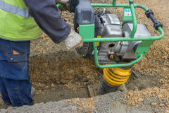 Worker with trench rammer 2 royalty free stock photos
