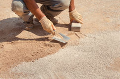 Worker with a trowel. Flat sand Royalty Free Stock Images