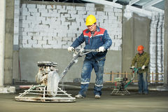 Worker trowelling and finishing of concrete Stock Image
