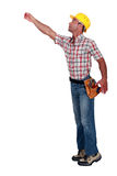 Worker trying to reach upwards Stock Images