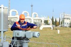 Worker turns bypass valve Stock Image