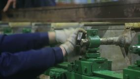 Worker turns the nut with a large wrench stock video footage