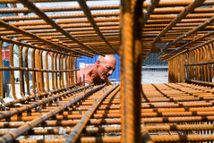 Worker tying rebar for construction Stock Images