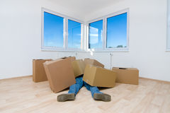 Worker under boxes. An accident showing a worker lying underneath the cardboard boxes he was carrying Royalty Free Stock Image