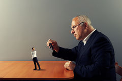 Worker under magnifying glass his boss Royalty Free Stock Photos