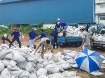 Worker under preparing a sand bag. CHONBURI THAILAND - OCT 16 : Worker under preparing a sand bag, Water flooding attack to Amata Nakorn Industrial Estate on Oct Stock Photos