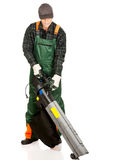 Worker in uniform with a leaf blower Royalty Free Stock Photography