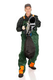 Worker in uniform with a leaf blower Royalty Free Stock Photo