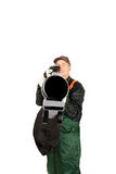 Worker in uniform with a leaf blower Royalty Free Stock Image