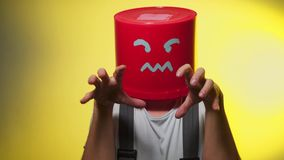 Worker in uniform with red bucket on his head angry stock footage