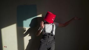 Worker in uniform with red bucket on his head have fun and dancing stock footage