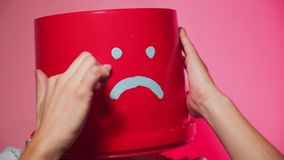 Worker in uniform with red bucket on his head sad stock footage