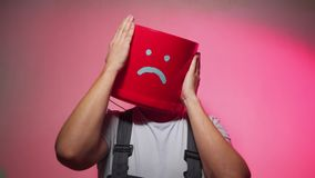 Worker in uniform with red bucket on his head sad stock video