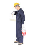 Worker in uniform using paint roller is painting invisible wall Stock Image