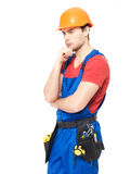 Worker wearing the helmet  thinking Stock Photos