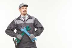 Worker in uniform with wrench. Isolated white background Stock Images