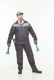 Worker in uniform with wrench royalty free stock photography