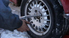 Worker untwists wheel. Worker unscrews the wheel of the car close-up stock video footage