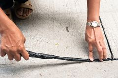 Worker use bitumen emulsion to apply the joint of road. Worker use bitumen or asphalt emulsion to apply the joint of road stock image