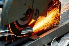 Worker Use Chop Saw to Cutting a Thick Stainless Steel Tube in a. Construction Work Site stock photos