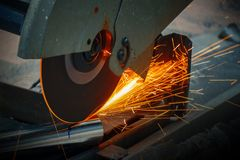 Worker Use Chop Saw to Cutting a Thick Stainless Steel Tube in a. Construction Work Site stock image