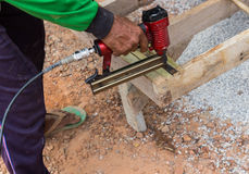 The worker use the drill to assemble the wooden seat Royalty Free Stock Photo
