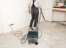 Worker use vacuum cleaner in construction. Worker man use vacuum cleaner in construction Royalty Free Stock Photos